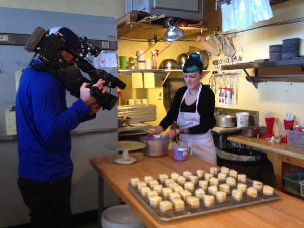 icing the petit fours on camera